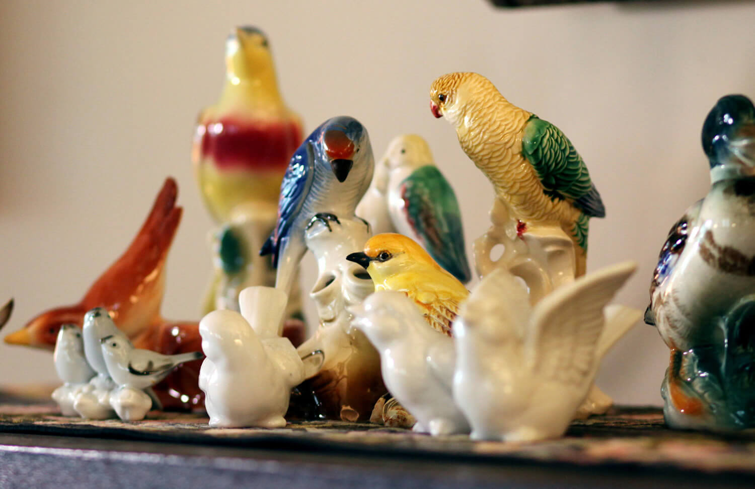 collection of ceramic birds in blue, green, red and yellow