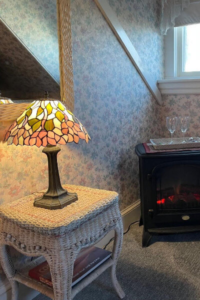 Forest green mug with inn logo and location in gold